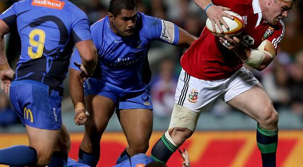 Cian Healy, centre, has been cleared for an alleged biting incident against Western Force