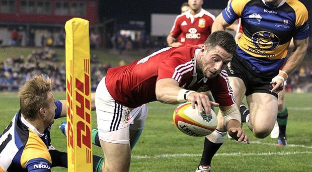 Alex Cuthbert, centre, scored one of his side's 10 tries
