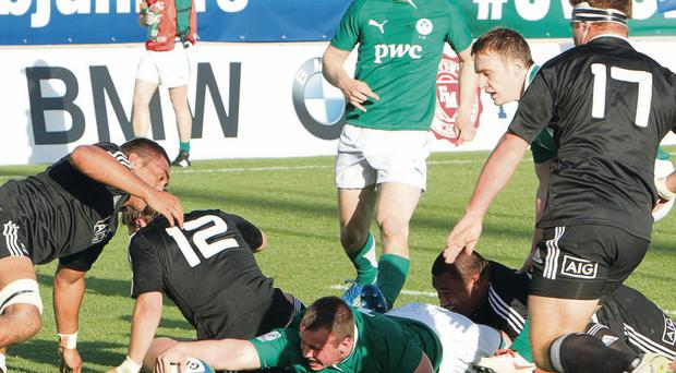 Ireland's Ed Byrne stretches to score a try