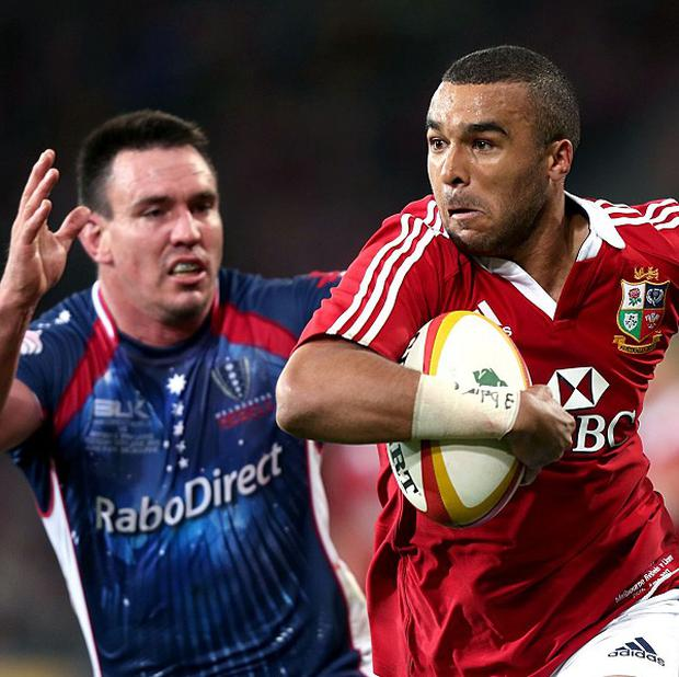Simon Zebo, right, was lifted by Lachlan Mitchell during the Lions' 35-0 victory