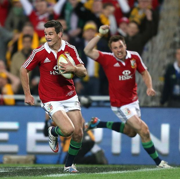Jonathan Sexton, left, scores a try for the Lions