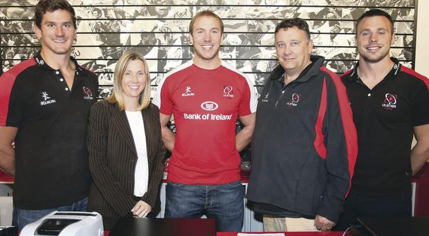 Kitted out: Robbie Diack, Fiona Hampton (Ulster Rugby's head of sales and marketing), Tommy Bowe, Stephen Ferris and Terry Jackson (director and general manager of Kukri Ireland) celebrate the new five-year sponsorship deal