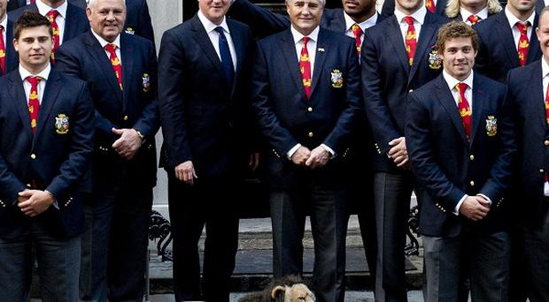 Manu Tuilagi has apologised for making the gesture behind Prime Minister David Cameron's head