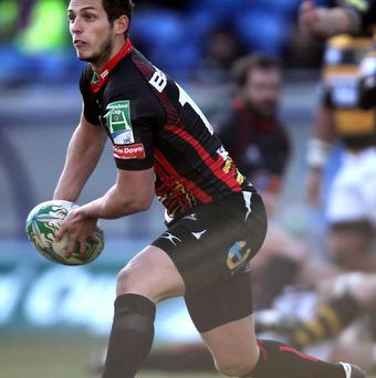 Jason Tovey's form with the boot helped guide Newport Gwent Dragons to victory over the Scarlets.