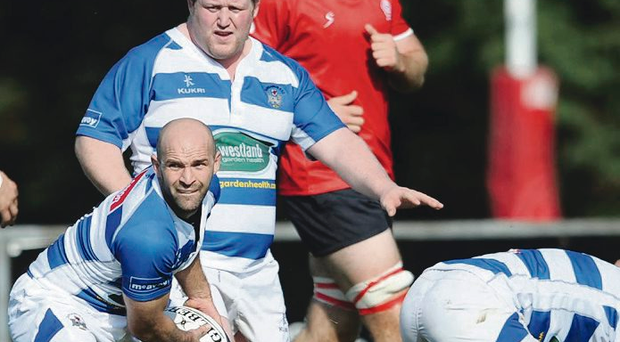 Work Dun: James Bates bids to get Dungannon moving in their Gibson Park defeat by Malone in AIL Ulster derby