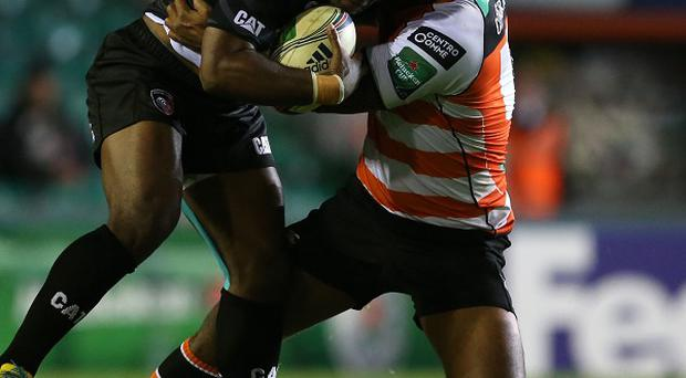 Leicester Tigers' Vereniki Goneva, left, tries to break through in Leicester's convincing victory