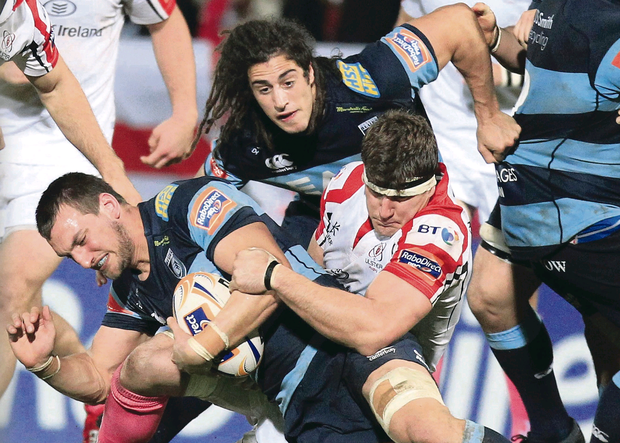 Ulster's Robbie Diack tackles Cardiff's Sam Warburton