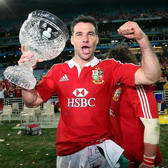 Wales assistant coach Rob Howley believes the 2015 World Cup is a realistic target for scrum-half Mike Phillips, pictured