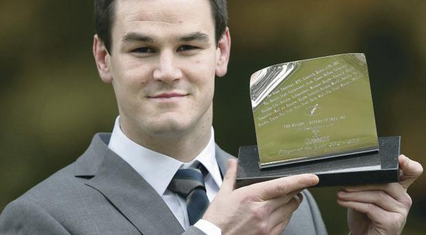 Prize player: Jonny Sexton picks up the Guinness Rugby Writers of Ireland Player of the Year 2013 award