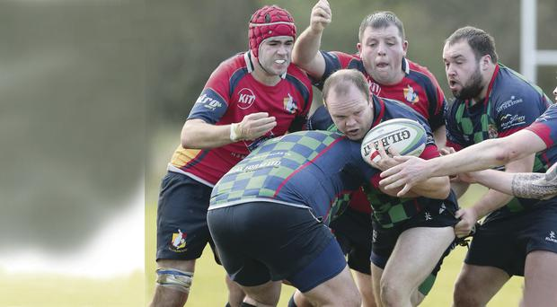 No way through: BJ Wilson of Clogher Valley is stopped during Saturday's clash at The Cloghan