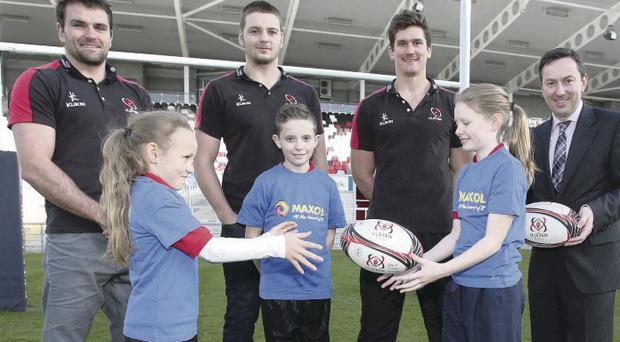 Big boost: Ulster's Jared Payne, Iain Henderson and Robbie Diack with Brian Donaldson of Maxol and Primary 7 children from Elmgrove School, Belfast (left to right) Gemma McCullough (10), Joshua Fisher (11) and Kym Mitchell (11)
