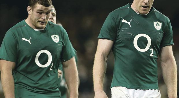 Heads bowed: Jack McGrath and Paul O'Connell trudge off after last Saturday's heavy defeat to Australia