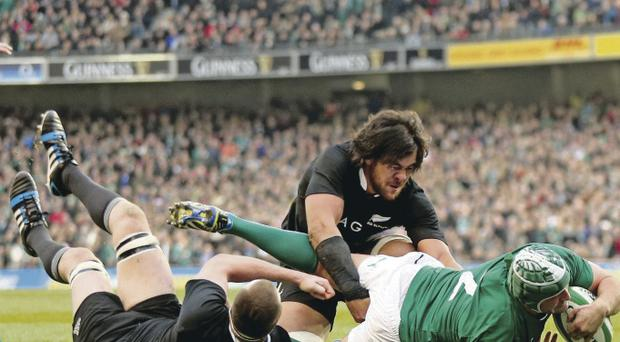 Rory Best scores his sides second try despite Luke Romano and Sam Whitelock of New Zealand