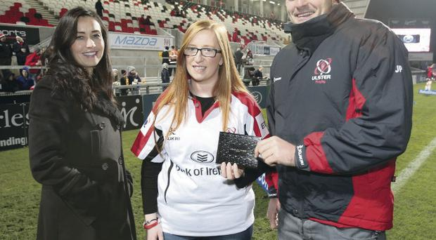 Ulster's Jared Payne receives the Bank of Ireland Player of the Month Award for October from Ulster fan Melissa Clydesdale and Joanne McGowan, Head of Development and Marketing at Bank of Ireland