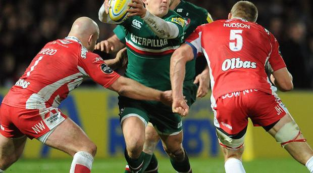 Leicester Tigers' Toby Flood (centre) is tackled by Gloucester Rugby's Nick Wood (left) and James Hudson (right) during the Aviva Premiership match at Kingsholm Stadium, Gloucester.