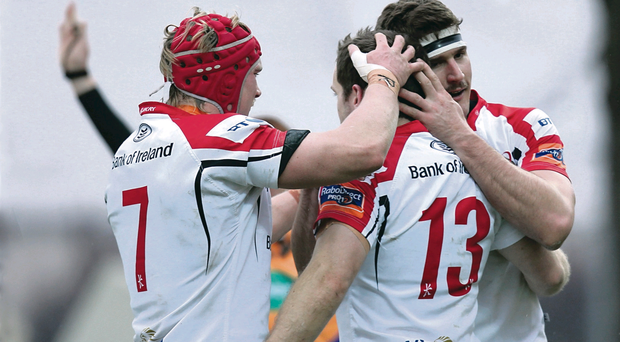 Darren Cave (centre) is congratulated by Mike McComish (left) and Neil McComb after scoring Ulster's only try against Zebre