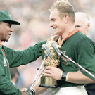 Nelson Mandela presents South Africa's Francois Pienaar with the Webb Ellis Trophy in 1995