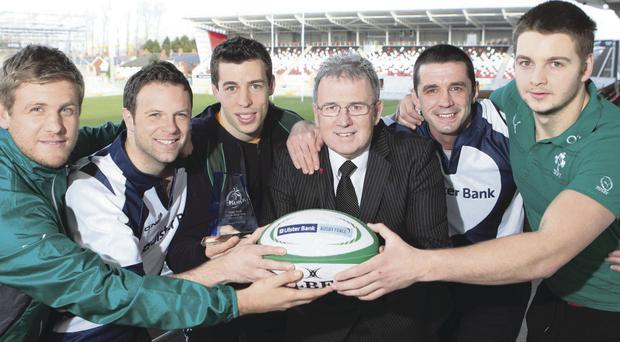 Bank on it: Irish rugby stars Chris Henry (left) and Iain Henderson (right) were on hand at Ravenhill to launch the Ulster Bank League Awards for 2013/2014. Also pictured are Ulster Bank rugby ambassadors Bryn Cunningham (2nd left) and Alan Quinlan (2nd right) with Stuart Morrow, Ballynahinch RFC captain and Stephen Cruise from Ulster Bank