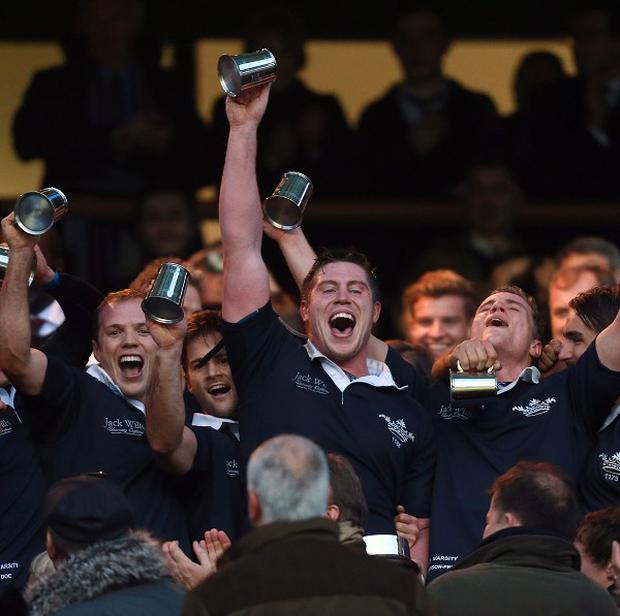 Oxford players celebrate their victory in the 2013 Varsity match at Twickenham, London