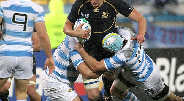 Scotland's Richie Gray is tackled by Argentina's Genaro Fessia (right) and Martin Scelzo during the 2011 World Cup. The sides will meet twice next year.