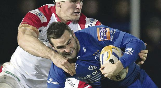 Leinster's Dave Kearney is tackled by Ulster's Robbie Diack at the RDS in Dublin