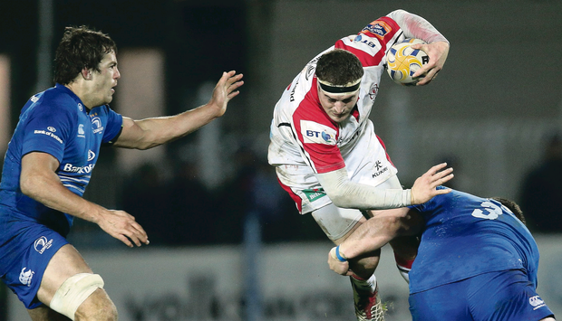 Ulster's Rob Herring is tackled by Martin Moore of Leinster