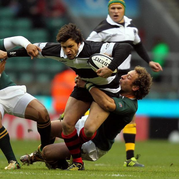Andries Strauss, pictured right tackling the Barbarians' Adam Ashley-Cooper, has joined Edinburgh.