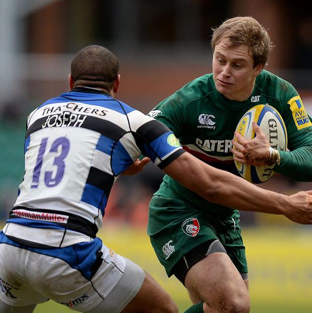 Leicester's Mathew Tait (right) hands off Bath Rugby's Jonathan Joseph at Welford Road