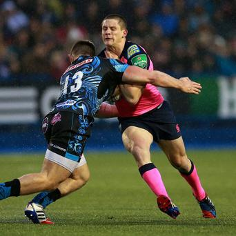 Cardiff's Lloyd Williams is tackled by Exeter's Sam Hill during the Heineken Cup, Pool Two match at Cardiff Arms Park, Cardiff.