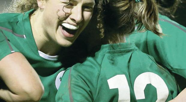 Try that: Ireland's Lynne Cantwell celebrates her try against Scotland in Ashbourne with Jenny Murphy