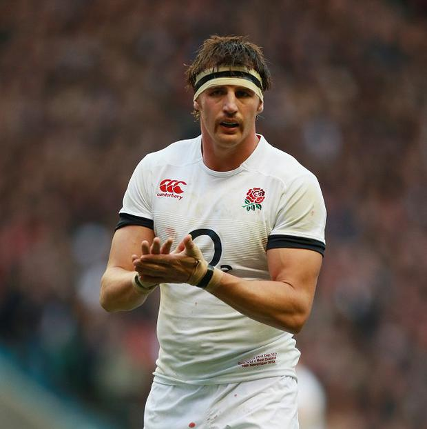 Flanker Tom Wood is braced for an onslaught from the France pack