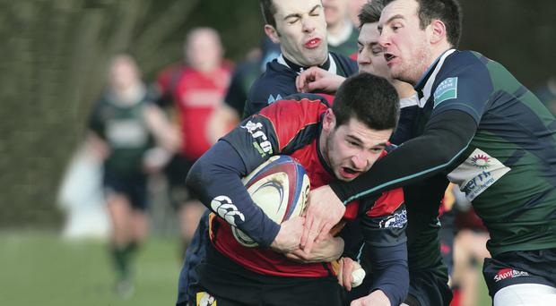 Marked man: Ballyclare's Adam Warden tussles with Chris Cahoon of Grosvenor