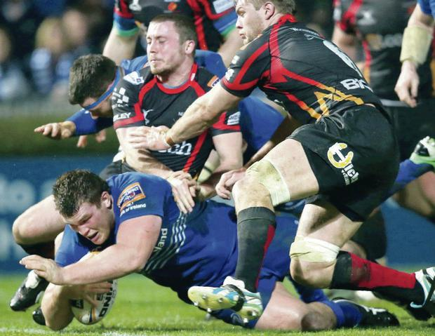 Powerhouse: Leinster's Jack McGrath goes over for a try against the Dragons at the RDS