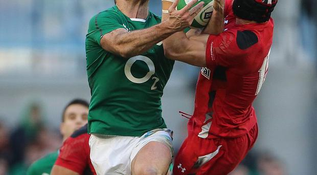 Rob Kearney, pictured left, grapples with Wales' Leigh Halfpenny, and will expect more of the same against Mike Brown and England