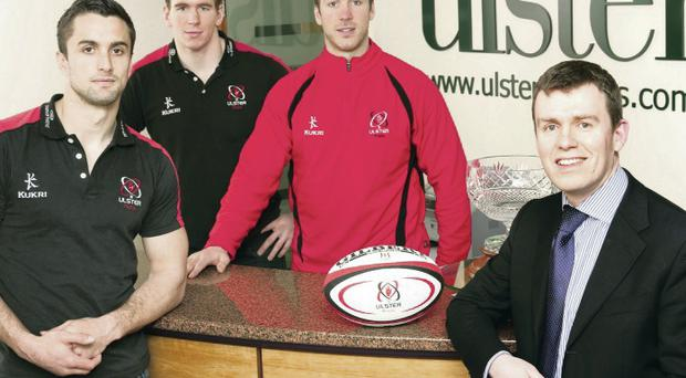 Winning team: Ulster Rugby stars David McIlwaine, Chris Farrell and Stephen Ferris are pictured at Ulster Carpets with the company's Finance Director, David Acheson