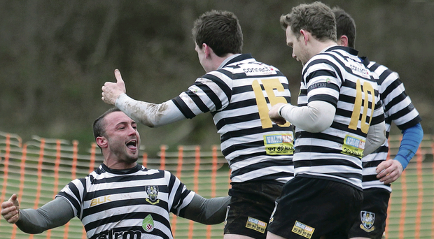 Try that: Andy Hodgen of C.I is mobbed after opening the scoring on Saturday
