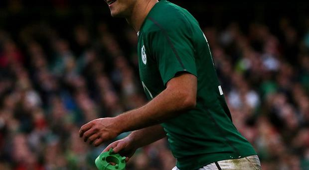 Ireland and Racing Metro are at loggerheads over the severity of Johnny Sexton's thumb injury