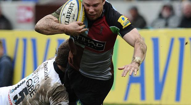 Sam Smith, here being tackled, helped Harlequins see off Worcester in the Aviva Premiership.