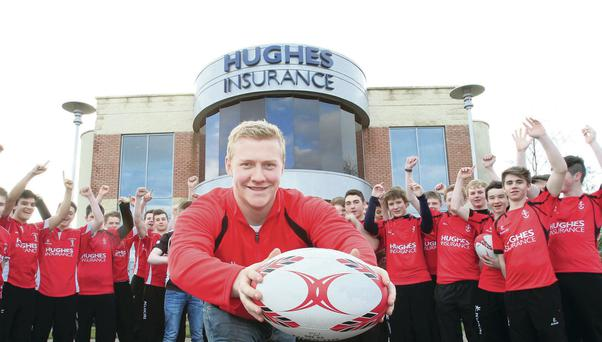 Stuart Olding, a Hughes Insurance Ulster Rugby Academy graduate, joins players from Regent House and Ards Under-17s at Hughes Insurance in Newtownards