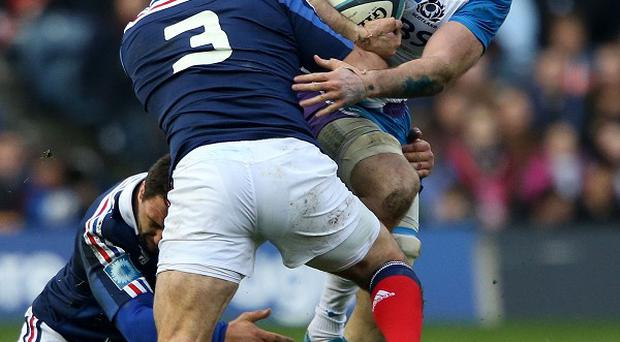 Johnnie Beattie, right, injured his right ankle against France
