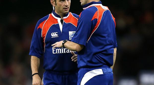 Romain Poite, left, was in charge of Sunday's RBS 6 Nations clash between England and Wales