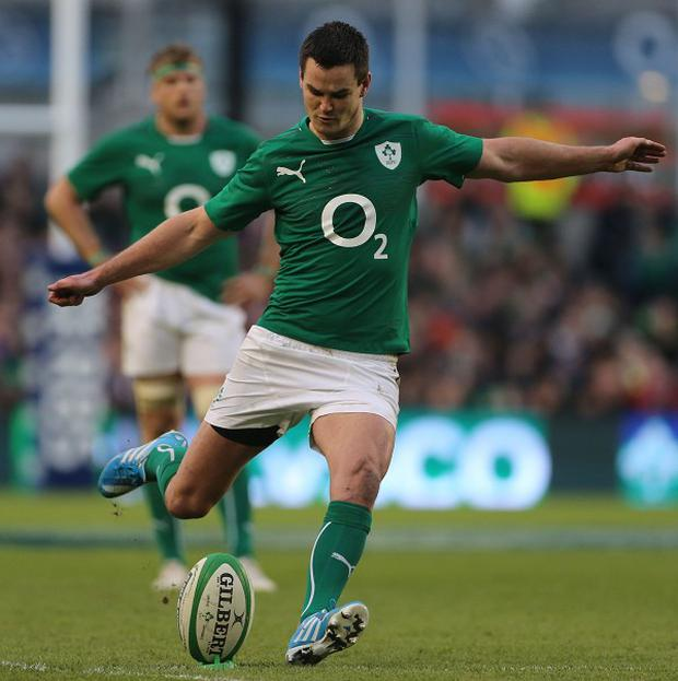Ireland boss Joe Schmidt does not expect Johnny Sexton, pictured, to return home early from France
