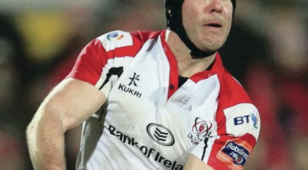 Ulster's Stephen Ferris is tackled by the Scarlets Olly Barkley