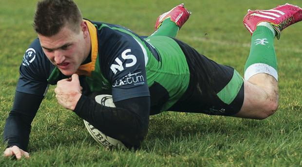 Touchdown: Rodger McBurney goes over for Ballynahinch