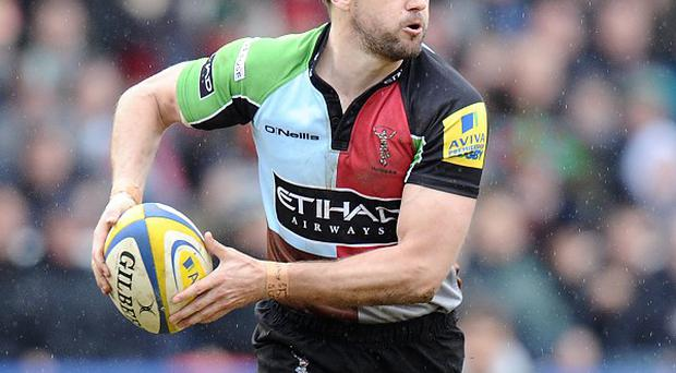 Nick Evans scored 12 points as Harlequins kept their Aviva Premiership play-off hopes alive