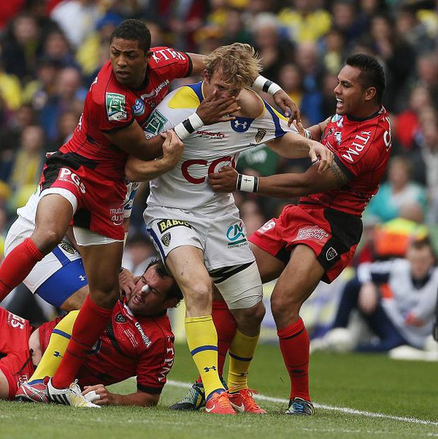 Clermont Auvergne's Aurelien Rougerie (centre) is tackled by Toulon's Delon Armitage (centre left) during last year's Heineken Cup final