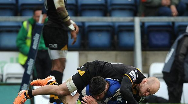 Bath's Rob Webber, floor, scores his side's second try of the game under pressure from Wasps Joe Simpson during the Amlin Challenge Cup semi-fiinal match at Adams Park