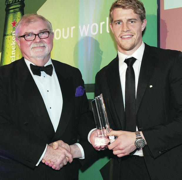 A delighted Andrew Trimble receives his Ulster Rugby Writers Player of the Year award from Jim Neely