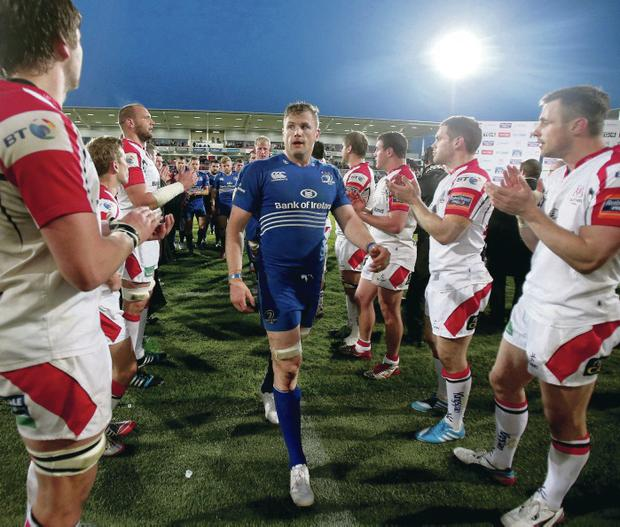 Round of applause: Ulster stars clap Jamie Heaslip and his Leinster team-mate as they leave the field earlier this month