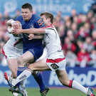 Closed down: Tommy Bowe and Luke Marshall stop Brian O'Driscoll in his tracks earlier this month